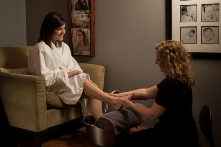 Staged advertising photograph of a woman receiving a professional pedicure by Kelly Ann Photos Ohio